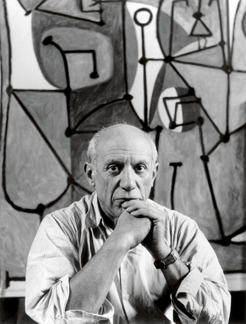 Pablo Picasso in front of <i>The Kitchen</i> (<i>La cuisine</i>, 1948) in his rue des Grands-Augustins studio, Paris, 1948